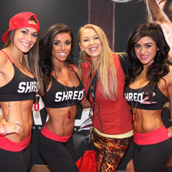 Elisabetta Rogiani at Shredz booth with models wearing Rogiani